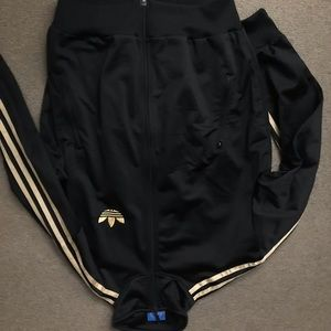 Black and gold womens adidas track jacket
